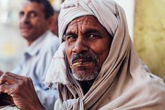 Bidi Smoking Man, Vrindavan India (AdamCohn) Tags: adamcohn hindu india vrindavan bidi cigarette holi man oldman pilgrim pilgrimage portrait smoke smoking होली face