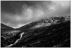 Coire Ghaisgeach storm light (Hugh Stanton) Tags: mountain storm water