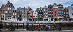 2018 - Amsterdam - Streetscape (Ted's photos - For Me & You) Tags: 2018 amsterdam cropped nikon nikond750 nikonfx tedmcgrath tedsphotos vignetting streetscene streetscape bikes bicycles windows doors railing wideangle widescreen