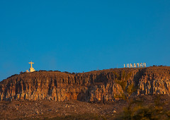 Cristo Rei christ near a giant billboard of lubango in the hollywood style on the top of a hill, Huila Province, Lubango, Angola (Eric Lafforgue) Tags: africa angola angola180024 architecture art catholic christtheking christian christianity christorei colourimage copyspace cristorei day developingcountries giantletters hill horizontal huilaprovince humanrepresentation jesuschrist lubango monument nopeople openarms outdoors portuguesecolony religion sculpture spirituality statue ao