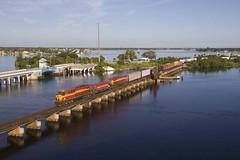 Sunshine State (Colin Dell) Tags: floridaeastcoastrailway fec lng set engine train bridge