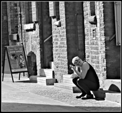 Moment of respite (ronramstew) Tags: city liverpool candid street bw blackandwhite 2018 2010s woman fatigue streetphotography