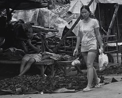 Done Shopping (Beegee49) Tags: man woman shopping charcoal street bacolod city philippines