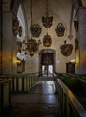 Central aisle of the Dome church (Tigra K) Tags: tallinn harjucounty estonia ee 2018 architecture baroque candle carving church gothic interior iphone lantern light metal object painting portal religious repetition rhythm toomkirik wood art arch pattern