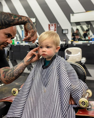 Clark's First Haircut - During (Chase Hoffman) Tags: colorado color chasehoffman denver chasehoffmanphotography cute summer portrait person face clark chair fujifilm fujifilmxt10 fuji fujinonxf23mmf14r normal haircut yeahbud boy barber properbarbershop barbershop toddler