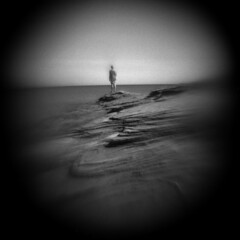 Overlook (LowerDarnley) Tags: holga modifiedcamera flippedlens relocatedlens pei princeedwardisland sea seaview atlanticcanada maritimes rocks coast figure vignette