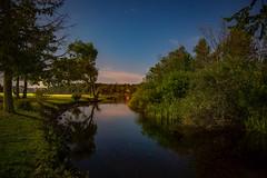 Moonlit River (T P Mann Photography) Tags: trees ngc serene lake rural michigan ellsworth puremichigan breezeway water river light reflections sky night stars moonlit moonlight
