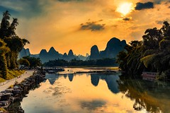 Yangshuo (Rod Waddington) Tags: china chinese yangshuo karst mountains landscape light sunset water boats reflection outdoor clouds path nature river li