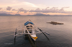 Sorsogon Bay (pietkagab) Tags: philippines luzon bicol sorsogon bay water sea boat sunset evening islands mountains asia asian southeast bangka fishing pietkagab photography pentax pentaxk5ii piotrgaborek travel trip tourism sightseeing adventure landscape waterscape sky pastel colour
