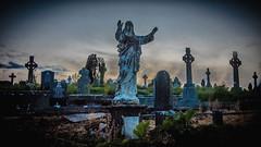 Irish Jesus II (HeinzDS) Tags: jesus bantry ireland sunset cork graveyard friedhof statue skulptur