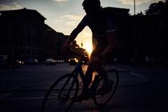 Sunset rider (iamunclefester) Tags: münchen munich bicycle bike sunset shade speed fast sky dark dusk house street