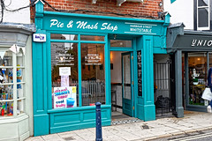 Pie & Mash (Geoff Henson) Tags: shop pavement bollard reflection pie mash street road