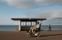 Llandudno Promenade (Roelie Wilms) Tags: llandudno promenade fietsen training seafront victorianextravaganza wales greatbritain england uk rainshelter dudes wheelchair beard cap scootmobile