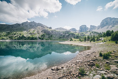 Lac d'Allos. (Matthieu Robinet) Tags: lake mirror reflexion landscape alps alpes mountains trees forest temperate cold summer trekk trail discover explore traveling everywhere naturalistic frenchphotographer picoftheday daily lostplaces secret cloudy mercantour nationalpark towers powerful discovery geographic alone imaginary wanderlust stayandwander another escape wideangle sonya7ii paysage france