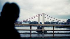 Thames Crossing: London England (Mike Cook 67) Tags: london longshot railway bridge nikonf80 nikon50mmf18glens analogue analogphotography riverthames 35mmfilm