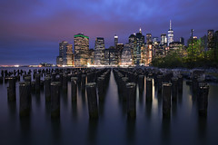 east river (Andy Kennelly) Tags: new york ny nyc newyorkcity lower manhattan afterdark night lights reflections pier pilings clouds city blue hour