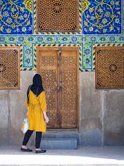 Tilework in Esfahan, Iran (TeunJanssen) Tags: iran esfahan middleeast travel traveling worldtravel worldtrip backpacking olympus omd omdem10 tile tiles tilework isfahan geometries patterns woman scarf door decoration architecture 45mm
