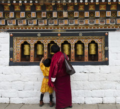 Grandmother and Child Praying (William J H Leonard) Tags: thimphu bhutan bhutanese southasia southasian summer sunny travel travelphotography travelling tashichhodzong buddhist buddhism buddhisttemple architecture asianarchitecture people portrait portraiture portraits building
