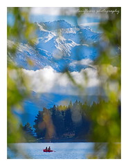 Their world. (natureflower photography) Tags: landscape foreground curtains row boat lake blue mountain beautiful leaves clouds bokeh
