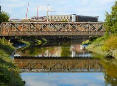 Bridge over the Mersey river, Warrington, UK (uk_dreamer) Tags: bridge iron steel metal rust decay water reflection reflections warrington mersey river wet railway city landscape skyline reflected
