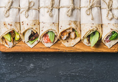 Tortilla wraps with different fillings on dark grey concrete background (Taco Shop Tyler) Tags: wrap tortilla filling food topview snack healthy lunch bite takeaway copyspace dark concrete grunge black salmon ricotta creamcheese chicken vegetable mozzarella sandwich driedtomato basil fresh herb leaf mexican above burrito closeup cuisine dinner fastfood flatbread meal row streetfood homemade horizontal wheat savory portion board meat negativespace text menu fish