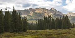 Snowdon Peak from Big Molas Lake (TWK2011) Tags: water lake sunrise rocks mountains clouds trees pine evergreen glow haviland colorado usa