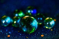 Marbles (eleni m) Tags: marbles glass macro bokeh colours colourful bubbles blue green yellow orange
