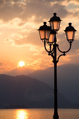 Lamps (davidepremoselli) Tags: nature water canon clouds lago lake lamp reflex sigma sun sunset wind cielo montagna paesaggio tramonto