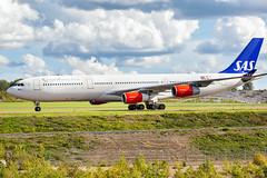 OY-KBI Airbus A340-313 SAS Scandinavian Airlines (Andreas Eriksson - VstPic) Tags: oykbi airbus a340313 sas scandinavian airlines scandinavian964 from hong kong
