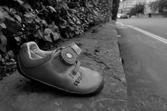 Shoe on the wall (matthew-woodward) Tags: walkamileinmyshoes walk shoes lonesomeshoe loneliness