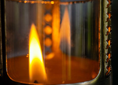 Flame Reflected (San Francisco Gal) Tags: macromondays glass macro candle flame reflection votive lantern