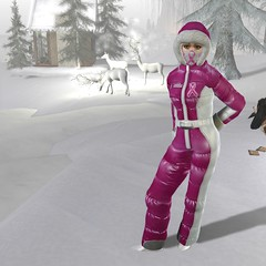 The skier with the pink ribbon (almut.brunswick) Tags: schnee snow winter onepiece skioverall