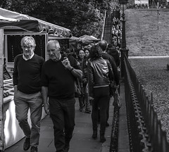 Lead the way_G5A0253 (ronniefleming@btinternet.com) Tags: candid streetportraiture rawstreetphotography edinburgh thefringe bw blackandwhite ph31fy ronniefleming city street railing stairs marketstalls