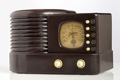"""Vintage 1939 tube Zenith Bakelite Table Radio - The radio had tip-touch automatic tuning controls with a broadcast band from 550 to 1700kc. This radio is often referred to as the """"Zenith Beehive."""" (thstrand) Tags: 1930s 1938 1939 20thcentury am antique antiquesandcollectibles architecturalstyles architecture artdeco artifacts baekelite bakelite brand broadastband broadcasting broadcasts brown case casing casings communication communications dial dials domestic electrical entertainment front goldenage historicartifact history home industrialdesign isolatedonwhite knob knobs leobaekeland media molded news nobody old oneobject plasticcase radio radiobroadcast radiodial radioreceiver radios recreationentertainment retro science settings stations streamline streamlinedesign tablemodel technology telecommunications tiptouchautomatictuningcontrols tube tubes tuner vintage wireless zenith zenithbeehive"""