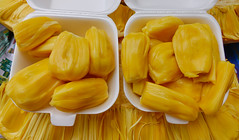 Jackfruit for sale at market (phuong.sg@gmail.com) Tags: agriculture artocarpus asia asian background big country delicious dessert detail dish fenne food fresh fruit green healthy heterophyllus jack jackfruit jak juicy kathal life light market natural nature organic plant raw ripe round stem still summer sweet table tasty texture tree tropical vegetable white wood wooden yellow