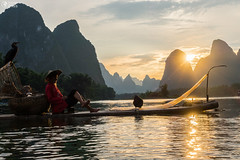 Yangshuo, China Sunset Landscape on Calm River with Villager on Boat (HunterBliss) Tags: ancient asia asian beautiful china chinese clouds cloudy countryside county day destination dusk famous forest green guangxi guilin hill hills karst landmark landscape li lijiang limestone morning mountain mountains natural nature outdoor outdoors place river rural scene scenery scenic sunrise sunset tourism town travel valley view village water xingping yangshuo