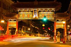 Traffic Flow through the Gates of Chinatown (vanessa_macdonald) Tags: chinatown gates gate chinese victoriabc bc victoria fisgard britishcolumbia vancouverisland nightphotography canoncanada cartrails longexpo westcoast city urban