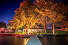 Cottage, Canandaigua Lake (jpetcoff) Tags: ring fire canandaigualake night evening summer warm water upstateny rochester finger lakes annual event stars trees reflection