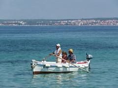 Returning from the beach (elkarrde) Tags: summer summer2018 august 2018 august2018 sea boat rowboat people beachgoers preko croatia adriatic adriaticsea summertime vacation sunny sunnyday panasonic panasoniclumixdmcgx7 panasonicgx7 gx7 dmcgx7 camera:brand=panasonic camera:model=dmcgx7 camera:mount=microfourthirds camera:format=microfourthirds microfourthirds digital digitalphotography mediumdigital olympus olympuszuikodigital zuikodigital olympuszuikodigital50200mm12835 zuiko 50200mm olympuszuikodigital50200mmf2835 100400mme 502002835 lens:brand=olympus lens:model=zuikodigital50200mm12835 lens:mount=fourthirds lens:format=fourthirds lens:focallength=50200mm lens:maxaperture=2835 clearsky clear mediterranean twop water