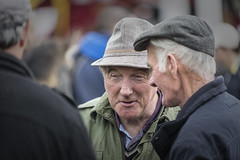 With a twinkle in his eye (Frank Fullard) Tags: frankfullard fullard candid street portrait twinkle jolly conversation talk group cap hat ballinasloe galway horsefair fair irish ireland talker