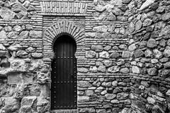 The Door (petia.balabanova(tnx for +3 million views)) Tags: door stones blackandwhite bw monochrome malaga spain andalusia alcazaba nikond800 2470mm travel architecture