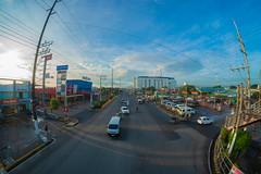 Mornings @ Pacita Complex (AllanAnovaPhotos) Tags: fisheye 8mm samyang rokinon pacita pacitacomplex sanpedro sanpedrolaguna laguna philippines roads vehicles cars clouds sky skies blue