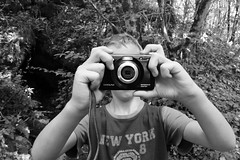 Young photographer (Cosentino Aran) Tags: young photographer photo blackandwhite monocromatico forest passion nature cave river boy newyorkcity nyc child