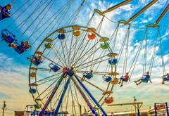 Swings at the Fair (yerica38) Tags: ride park amusement amusementpark fair windosr windsorfair windsormaine countyfair fun vintage texture wheel ferriswheel round circle high dramaticsky sky seat colorful swing swingride around children themepark