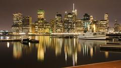 Manhattan Skyline 53 (Sanyam Bahga) Tags: d7000 1024 usa newyork newyorkcity manhattan brooklyn brooklynbridgepark skyline skyscraper reflection eastriver estuary night nyc water fdrdrive