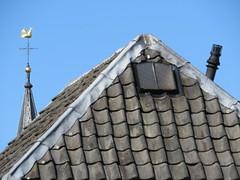 Rooftops - Top Roofs (Mattijsje) Tags: roof rooftops church cock kerkhaantje torenspits tip tower dakpannen pannen tiles rooftiles chimney schoorsteen cross kruis