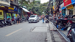 Huddling with Motorcycles (marcocarag) Tags: hanoi vietnam vnm