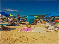 Sombrilla (Nacho Pérez Ortiz) Tags: beach sombrilla sky sand people sea beachumbrella