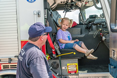 Andi loves to chat with firefighters (Charles G. Haacker) Tags: trucks trains planes automobiles tractors fireengines firefighters stearman airfield