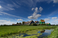 The Red Roofs of the Grotewerf (Johan Konz) Tags: island marken house waterland netherlands watercourse water grass blue sky white cloud outdoor scenery nikon d7500 landscape field grassland polfilter terp hamlet grotewerf green wall red roof painting reed waterplant reflection eu